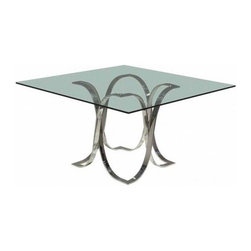 Glass, Wood or Metal Dining Table - Another big draw of a glass surface is that most people feel entirely comfortable using it 'as it comes'; without feeling the need to dress the surface with a tablecloth. The look is smart and formal without being stuffy (and results in less laundry).