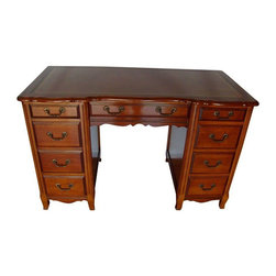 Used Vintage Cherry Kneehole Desk by Sligh-Lowry - This pretty vintage desk is constructed of solid cherry with a leather top. It is signed Sligh- Lowry, Holland, Michigan. It has normal surface wear and age marks and the leather has some crazing, but over all it is in good condition. The desk has eight drawers with one being a file drawer.