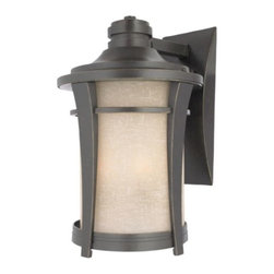 Quoizel - Harmony Outdoor Wall Sconce by Quoizel - Minimal ornamentation and gentle curves give the Quoizel Harmony Outdoor Wall Sconce its sense of strength and tranquility. It features a Cream Linen glass shade protected and accentuated by a cast aluminum frame in an Imperial Bronze finish. For more than 80 years, Quoizel (based in Charleston, SC) has dedicated itself to bringing timeless lighting designs into modern homes. By consciously avoiding design fads, consistently balancing form and function and using only the highest quality materials, Quoizel lighting designs do indeed stand the test of time.