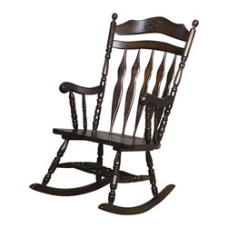 Coaster - Coaster Traditional Country Wood Rocker - Coaster - Gliders and Rockers - 600187 - This lovely wooden rocker will be a nice addition to your country style home. The high chair back has a shaped top splat with a pretty floral carving above elegant double arrow slats. A deep wooden seat will keep you comfortable as you relax and rock in this beautiful dark Walnut finished rocking chair. Soft curved arms frame the seat with turned spindle supports. Pretty turned legs above the wood rocker base complete this charming country style look. Add this beautiful rocker to your home for a touch of warm tradition. Choose from a variety of stunning styles in this groups of rocking chairs. Sit back and relax enjoying the soothing rocking motion. With different design styles and wood finishes available you are sure to find the perfect fit for your home. Add a rocker to your living room den library or bedroom to create a calming and relaxing space without compromising your unique style.