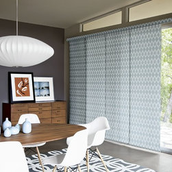 Smith and Noble Roller Panel Track Shades - Whether you're seeking the drama and fashion appeal of fine fabric, or the rich texture of woven wood blinds, you'll find a budget-wise, easy-care solution in smith+noble Roller Shades. Starting $87+