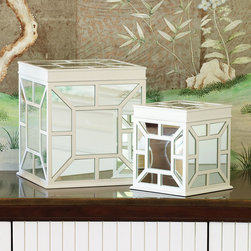 Ariana Box - Dramatic and international, the Ariana Box is a lidded cube with a striking arrangement of mirrored tiles on each side � symmetrical, radiant, and geometric with white wood outlines to add a beautiful concentration of light in three dimensions to a spot in your home.  Use its window-like mirror panes to enhance the depth of a tablescape or brighten the effect of a mantelpiece arrangement.