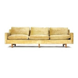 EcofirstArt II - A three-seat sofa in the yellow velvet upholstery on chamfered dowel legs. Designed by Edward Wormley.