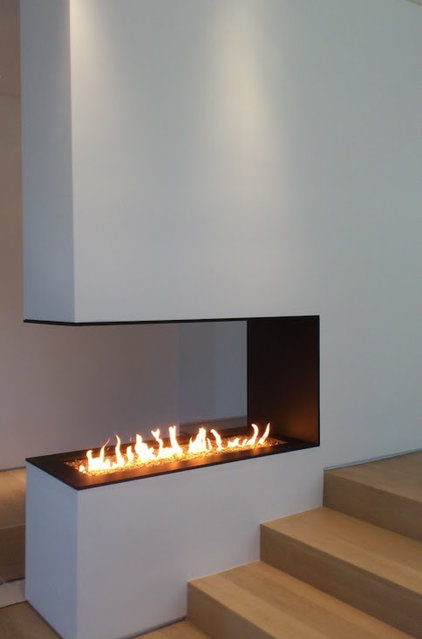 Modern Indoor Fireplaces by Construction M Lambert Inc