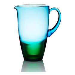 """Frontgate - Kim Seybert Vague Pitcher - Designed by Kim Seybert. Heirloom-quality artisanal barware makes a perfect wedding or housewarming gift. 100% handmade glass. Dishwasher-safe. A modern yet timeless heirloom, our Kim Seybert Vague Glass collection breathes fresh life into the ancient art of glass blowing. French for """"wave,"""" each Vague piece is handmade by Eastern European glass masters, with a stunning horizon where blue meets green glass.  .  .  .  . Handcrafted in Czechoslovakia."""