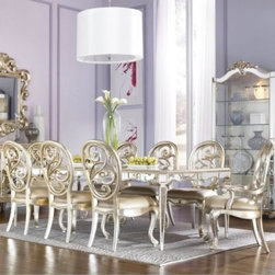 """American Drew Jessica McClintock Couture Antique Mirrored Dining Table - Silver - make an old-world-feel in your dining room with the American Drew Jessica McClintock Couture Antique Mirrored Dining Table - Silver Leaf. This dining table is mirrored and has a vine motif painted on the corners of the tabletop. With the help of two 24-inch leaves this 48-inch dining table extends 48-96 inches to accommodate larger gatherings. Bring home this antique mirror dining table and make a romantic ambience in your dining area. Table dimensions: 48-96L x 48.5W x 30H inches. This purchase is for dining table only please see """"""""Related Items"""""""" for matching chairs or complete dining set. About American DrewFounded in 1927 American Drew is a well-established leading manufacturer of medium- to upper-medium-priced bedroom dining room and occasional furniture. American Drew's product collections cover a broad variety of style categories including traditional transitional and contemporary. Their collections range from the legendary 18th-century traditional """"""""Cherry Grove """""""" celebrating its 42nd year of success to the extremely popular """"""""Bob Mackie Home Collection """""""" influenced by the world-renowned fashion designer Bob Mackie. """"""""Jessica McClintock Home"""""""" features another beloved designer bringing unique style to an American Drew line. American Drew's headquarters are located in Greensboro N.C. Their products are distributed through thousands of independently owned retailers throughout the United States and Canada and around the world."""