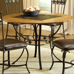 Hillsdale Furniture - Lakeview Round Dining Table w Metal Legs and - Composed of heavy gauge tubular steel, solid wood edges, climate controlled wood composites and veneers. Boasting a striking fusion of�� medium oak wood, coppery brown metal, and a dynamic slate inlay in the center of the table. Brown color. This unique group is a perfect addition to your home. 45 Dia. x 30 in. HRustic textures and colors combine to create Hillsdale Furniture̢s Lakeview dining collection.