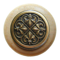 "Inviting Home - Fleur-de-Lis Natural Wood Knob (unfinished with antique brass) - Fleur-de-Lis Natural Wood Knob unfinished with hand-cast antique brass insert; 1-1/2"" diameter Product Specification: Made in the USA. Fine-art foundry hand-pours and hand finished hardware knobs and pulls using Old World methods. Lifetime guaranteed against flaws in craftsmanship. Exceptional clarity of details and depth of relief. All knobs and pulls are hand cast from solid fine pewter or solid bronze. The term antique refers to special methods of treating metal so there is contrast between relief and recessed areas. Alternate finishes are available. Detailed Description: The Fleur-de-lis means ""flower of the lily"" It was used to represent French royalty. It was said that the king of France Clovis who started using the symbol of the Fleur-de-lis because the water lilies helped guide him to safety and aided him in winning a battle. The design in the Fleur-de-Lis pulls is arranged in alternating positions of the Fleur-de-lis. These pulls are a great match for the Fleur-de-lis knobs which have the Fleur-de-lis pattern arranged in a circle. The different shapes of decorative hardware make the cabinet doors and drawers interesting to look at."