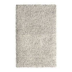 Bello Shag Rug - A thick, white shag rug will soften an industrial loft and provide just enough hominess to balance out cool, clean lines while warming up your feet.