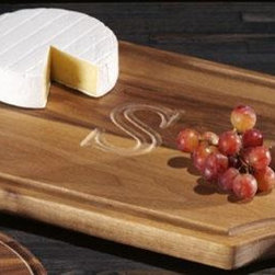 Home Decorators Collection - Chianti Cutting Board - Whether for adding a personalized touch to your kitchen decor or for a beautiful cutting board to serve appetizers when entertaining guests, this piece will remain a favorite part of your tabletop decor for years to come. For an added benefit, you can customize the look of your cutting board by choosing a single letter to be inscribed onto the surface. Place your order today and complete the look of your kitchen decor with a personalized touch. Crafted of durable hardwood for years of lasting use. Personalize with a single capital letter. Available with intricately carved metal handles for an additional charge; see pricing above.