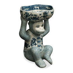 China Furniture and Arts - Hand Painted Porcelain Monkey W/Lotus Dish, Blue and White - A unique decorative object with practical use, this hand crafted monkey cheerfully holds a lotus dish which serves well to contain soaps, potpourri, candy, and other such items. Painted in classic blue and white color scheme, it makes a wonderful accent piece on any desk, table, or cabinet surface.