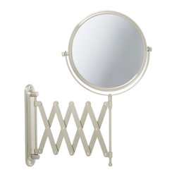 Jerdon JP2027N 8-Inch Two-Sided Swivel Wall Mount Mirror with 7x Magnification - The Jerdon JP2027N 8-Inch Two-Sided Swivel Wall Mount Mirror is used in luxury hotels and spas because of its convenience, sleek look and magnification. This two-sided circular mirror has an 8-inch diameter and features a smooth 360-degree swivel design that provides 1x and 7x magnification options to make sure every detail of your hair and makeup are in place. The extension arm and smooth rotation adjusts to all angles for a dynamic point of view. The JP2027N has a mounting bracket that measures 1.5-inches by 8.5-inches and extends 20-inches from the wall and can be easily moved around, while still being firm enough to hold for odd angles. This mirror has an attractive nickel finish that protects against moisture and condensation and is designed to be wall mounted. This item comes complete with mounting hardware. The Jerdon JP2027N 8-Inch Two-Sided Swivel Wall Mount Mirror comes with a 1-year limited warranty that protects against any defects due to faulty material or workmanship. The Jerdon Style company has earned a reputation for excellence in the beauty industry with its broad range of quality cosmetic mirrors (including vanity, lighted and wall mount mirrors), hair dryers and other styling appliances. Since 1977, the Jerdon brand has been a leading provider to the finest homes, hotels, resorts, cruise ships and spas worldwide. The company continues to build its position in the market by both improving its existing line with the latest technology, developing new products and expanding its offerings to meet the growing needs of its customers.