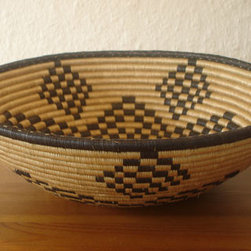 African Plateau Basket - Hand-crafted with needles and fine plant threats, these fair trade African Plateau Baskets are made by women of the Covanya cooperative in Rwanda. Their striking pattern makes them a natural centerpiece or decorative accent. Due to its handmade nature, each basket features slight variations in shape and color.