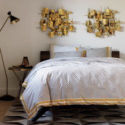 DwellStudio - Lucca Duvet Cover by DwellStudio - Give your bedroom a luxurious, worldly feel with the DwellStudio Lucca Duvet Cover. The tight geometric print is modeled on small-scale foulard patterns, and rendered using the traditional blockprint technique (with carved wooden blocks). The intricate pattern is framed by a bold border in a coordinating golden ochre. Shams sold separately. DwellStudio, founded in 1999 by Christiane Lemieux, specializes in home furnishings steeped in modern design. With a unique sense of color and a strong commitment to quality and innovation, DwellStudio continues to create its own distinctive interpretation of modern home furnishings. In the same creative spirit, the company encourages their customers to experiment with mixing various DwellStudio textile lines together.