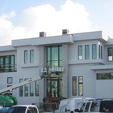 Modern Exterior by Arieno Custom Home Design