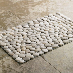 Black River Stone Mat - Made from river stones, this bathmat massages the feet, adding the natural element of rocks to the bathroom. Let your giftee toss out that moldy old rubber-backed mat and replace it with smooth stones.