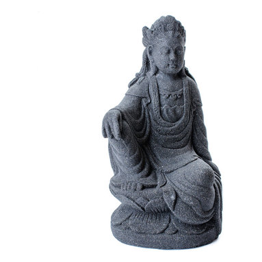 Repose Home - Imperial Quan Yin, Volcanic Black - A version of the great Goddess Tara exists in virtually every culture. As such, she is known to assume as many forms on earth as there are needs for the people. In this depiction, she is wearing flowing robes and is seated upon a lotus. She is cast in elegant, stonewashed volcanic ash and weatherproofed for use in the home or garden.