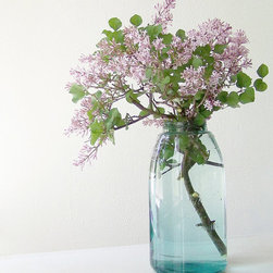 Century Old Half-Gallon Mason Jar by Midwest Finds - The ubiquitous blue Mason jars are so commonly used as vases, but they are still so beautiful. The blue really is the perfect accent to freshly cut stems from the garden.