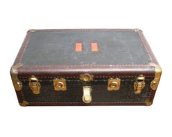 """Pre-owned 1914 Hartmann Black Steamer Trunk - The Joseph Hartmann Luggage Company was founded in 1877 in Milwaukee, Wisconsin. Hartmann strove to design luggage that was, """"so fine it will stand as a symbol of excellence,"""" and catered to the wealthy.     This vintage luxury trunk was likely manufactured at the turn of the century, around 1920, when the nation was in the midst of vast industrial growth. It would have been used for long distance travel on ships and the newly established railways traveling between 38 states. It has a distressed black exterior with oxblood colored leather piping along the edges. The brass hardware shows signs of wear and reads: """"Trademark Hartmann Feb 24 1914 Registered"""".    The trunk measures 36"""" long, 22"""" deep, 13"""" high. It's in good vintage condition. Hartmann trunks don't come up often, so do not delay!"""