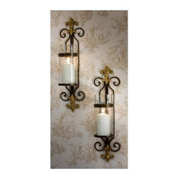 """Dessau Home - Fleur-De-Lis Candle Sconce w Rain Glass - Set - Set of 2. Includes 1 sconce. Brass accent medallion. Made from iron and brass. Made in India. 5 in. Dia. x 24 in. HValue has always been an essential ingredient at Dessau Home. """"Essentials"""" represents a collection of well-appointed yet affordable home furnishings with a unique traditional styling that appeals to most transitional and contemporary home decorating needs."""
