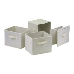 Winsome Trading, INC. - Winsome Wood Capri Foldable Baskets Storage Box (Set of 4) - 82411 ,Beige - Set of 4 Foldable beige fabric containers. Use the large size as a magazine holder, file holder, art project holder. The next 3 sizes are great for decorative storage and organization: washcloths in the bathroom, note pads at work, personal items in chest of drawers. When not in use, they fold for easy storage. Easy to assemble