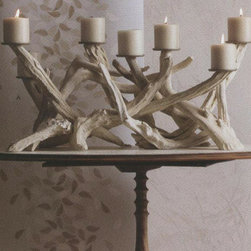 Driftwood Candelabra - Select pieces of driftwood are collected and repurposed into this dramatic candelabra.  Wind and waves began the weathering process, and we completed it by bleaching (with eco-safe peroxide) and sanding the wood and fitting each finished piece with seven metal discs to elevate votives or small pillar candles.  This stunning centerpiece is over two feet long and is sure to add lots of drama to a room.