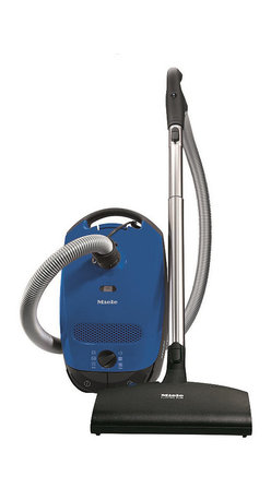 Frontgate - Miele Classic C1 Delphi Canister Vacuum - Powerful 1,200-watt Miele-made Vortex Motor. Six-stage suction control via rotary dial. AirClean System™ with unique AirClean FilterBags™ and filter. Telescopic stainless steel wand. Optional HEPA AirClean filter HA30. The Miele Classic C1 Delphi Canister Vacuum gently cares for all flooring in your home, from smooth, solid surfaces like tiles and hardwoods to low and medium-pile carpeting. This versatile vacuum includes the Electro Comfort electrobrush with a floating head and swivel neck design for use on low to medium pile carpeting, rugs and smooth flooring. The Delphi features a telescopic, stainless steel wand and long electrical cord with automatic rewind for a total cleaning radius of almost 30 feet. With six distinct power settings, it's easy to vary your vacuum cleaner's suction power according to the carpet pile, flooring and fabrics you're cleaning.  .  . AirClean System with unique AirClean FilterBags and filter .  .  . ElectroComfort mid-size electrobrush (SEB 217-3) . Deluxe handle grip with electrobrush control . Includes dusting brush, upholstery tool and crevice nozzle on VarioClip . Made in Germany.