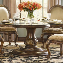 Hooker Furniture - Beladora Round Dining Table - Chairs not included. 0.50 in. lay-on glass top. Will comfortably accommodate six chairs. Made from hardwood solids with maple, olive ash burl and walnut veneers with resin accents. Caramel finish with gold tipping. Top: 72 in. Dia. x 0.5 in. H. Pedestal Base: 36 in. Dia. x 29.25 in. H. Overall: 72 in. Dia. x 30.50 in. H. Assembly InstructionsThe 70-piece Beladora collection of bedroom, dining, living room tables, home office and home entertainment furniture is the epitome of the grand European elegance many are looking for. Enrich you surroundings with the grand European elegance of Beladora. If you appreciate traditional forms, exquisite shapes, graceful curves and artistic hand work, the Beladora office collection by Hooker Furniture will inspire you as you work in your personal office space. The collection is dramatic and graciously scaled with maple and olive ash burl veneers accented by distinctive walnut inlays. Beladora pays homage to costly Old World antiques and showcases its exceptional design with a refined caramel finish with subtle gold tipping to accent the carving, chiseling and marquetry work all done by the hands of skilled craftsmen.