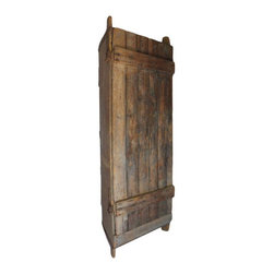 Used  Spanish Corner Cabinet - A wonderful antique Spanish corner cabinet. This cabinet has perfectly aged patina with a wood plank door and heavy iron hardware. This piece has a presence full of history and rustic charm.