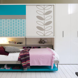 Poppiboard wall bed/desk unit - The Poppiboard space saving system consists of a wardrobe with sliding doors located above a twin wall bed. This unit has a desk on the front that remains parallel to the floor as the bed is opened, so items can be left on the desk even when the bed is folded out. Available with an optional fold up headboard. Contact info@homeelementfurniture,com for more information.