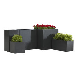 Campana - Fusion Modular Planter 17.5 x 17.5 x 35.5 Black - Fusion planters are a synthesis of traditional shapes and contemporary horizontal and vertical lines. The result is a collection that is understated but profound in it's uncluttered orderly imagery. New planter ideas of imagination, designed for durability and produced by a patented process. Medium weight for non-strenuous relocation. U.V. and frost resistant. Matte earth element colors portray natural aging.