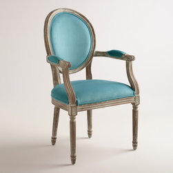 World Market - Peacock Blue Paige Round Back Armchair - Crafted of American white oak with velvety upholstery, our classic round back dining chair features wide arms with padded rests, making it a natural choice for the head of the table.