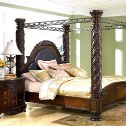 Millwood by ivgStores - King Size Bed w Inlaid Marble Veneer & Metal - With column style posts and a metal canopy with the look of wrought iron, this king size poster bed will be a stunning focal point as part of your bedroom decor. The bed is made of wood in dark brown finish and features intricate carved accents with rosette detailing. Collection: North Sea. Poster Bed includes Poster Headboard/Footboard Upholstered Panels, Poster Rails, Poster Headboard Posts, Poster Footboard Posts, and Canopy. Nightstand sold separately. Color/Finish: Dark Brown. Constructed with select hardwood veneers, hardwood solids and furniture grade resin. Dark casual finish. Dark colored metal accents & hardware. Large scale decorative pilasters and ornately detailed appliques. Mansion sized posterbed with upholstered headboard panel. Inlaid marble veneer caps on panel footboard. Panels: 71 in. W x 6 in. L x in. H. Poster Headboard/Footboar Posts: 12 in. W x 12 in. L x 91 in. H