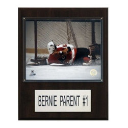 "NHL 12 x 15 in. Bernie Parent Philadelphia Flyers Player Plaque - Bernie Parent is celebrated on a 12"""" X 15"""" cherry wood plaque featuring a licensed 8X10 photo, one genuine licensed trading card of the player along with an engraved nameplate. Superior, high-clarity acrylic lens covers firmly affixed to the plaque with brass-type screws protect both the photo and trading card. The polished look makes for a well-crafted, long-lasting piece perfect for displaying in an office, recreation room, or any spot for a fan to enjoy. It is proudly produced and assembled in the U.S.A."