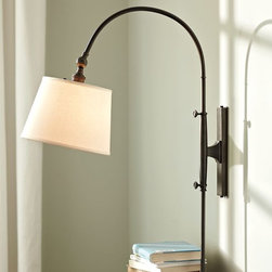 Adjustable Arc Sconce - I use swing arm sconces fairly frequently in small city apartments. Even if there is room for bedside tables, having the light on the wall allows for more usable space on the table. I also try to use paper or fabric shades, something that lets the light fill the room and not just create a spotlight over the bed corner — if that makes sense.