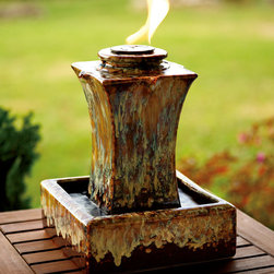 Ceramic Fire & Water Fountain - Top your table with a dramatic combination of water and fire! This ceramic fountain uses an ecofriendly gel for the flame.