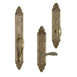 Georgica Entrance Handleset - The Georgica entry handleset by Omnia features a timeless arched handle and is available with either a knob or lever interior trim. Exquisitely designed to show off the embellished crests on both the top and the bottom, this handleset will be sure to make an elegant statement. Every inch of it has been expertly finished, from the leaf embellished on the handle to the detailed ridges on the sides. Even the tumbturn for the lock is ornamented. But beauty has not taken the place of safety, because hidden behind the ornate styling is a U.S.A made mortise lock.