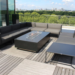 "Floating Granite Gas Fire Table - London Penthouse - Based on a sketch and the requirement that the granite should appear to be ""floating"" , we designed this stunning gas fire table made from granite and stainless steel. The gas fire table was to be installed on the 11th floor and had to be transported to its final location via a service elevator. With this in mind, the unit was designed in a series of pieces to aid delivery. The body was made from stainless steel and the outside skin of  nero assuluto granite was bolted to the sub frame. The unit was assembled in our factory before delivery to ensure that once on site, the unit could be rebuilt maintaining the very tight tolerances on the mitred granite corners."