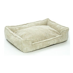 """Jax and Bones - Corduroy Lounge Dog Bed in Sand - Features: -Dog bed. -Corduroy fabric made from a washable blend of cotton and polyester. -Clean and contemporary complement to any room. -Sustainafill allergy-free eco-friendly fiber filling. -Hides shedding hair. -Gets softer and better over time. -Removable and machine washable cover. -Proudly made in the USA. -Sand fabric. -Available in four sizes. Specifications: -Small dimensions: 7"""" H x 18"""" W x 24"""" D. -Medium dimensions: 10"""" H x 27"""" W x 32"""" D. -Medium / large dimensions: 10"""" H x 32"""" W x 39"""" D. -Large dimensions: 12"""" H x 40"""" W x 48"""" D."""