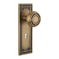 Nostalgic Warehouse - Nostalgic Mission Plate with Mission Knob and Keyhole in Antique Brass (715930) - The Mission plate in antique brass harkens to the Spanish Colonial period of the Western frontier, with an instantly recognizable square corner. Pair this with our Mission knob and its inlaid step design, to create a truly unique look. All Mission knobs are forged brass for durability and beauty.