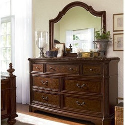 Villa Cortina 7 Drawer Dresser - Classic Cherry - Debate over your outfit, not your clothing storage system - the Villa Cortina 7 Drawer Dresser - Classic Cherry makes organization easy. Crafted with durable cherry and laurel burl veneers and select hardwood solids, this traditional dresser is outfitted with seven generously sized drawers - the bottom drawers have cedar bottoms to keep contents fresh and moths away. Elegant beaded trim, vintage-look pulls, and a rich cherry finish make this an instant heirloom. Choose to include a coordinating mirror or get the dresser only.Dimensions:Dresser: 72W x 22D x 43H in.Mirror: 52W x 3D x 44H in.About Universal Furniture InternationalRecognized as a leader in exceptionally crafted home furnishings, including bedroom and dining room items, entertainment centers, and more, Universal strives to make items that are styled to endure but always remain fresh. They make it a goal to include features that fit the way their customers live today, and to find prices that put high-quality products within reach. These are the principles that guide the work at Universal, essential elements of good, affordable, and smart design.