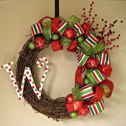 Christmas Wreath by Lantern in the Wood - This is a great wreath for the front door. I love the idea of welcoming your guests with such a festive pop of color, and the monogram makes it so much more personal.