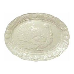 Ceramic Turkey Platter - Large vintage,creamy white turkey platter with an embossed turkey in the center and fruit, vegetables, and flowers around the edge.  It has a small chip on the underside of the rim but is not noticable on the topside.
