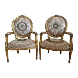 Used Gilt Louis XVI Chairs in Donghia Suzani - A Pair - Pair of Louis XVI gold gilded chairs uphosltered in Donghia Suzani Jaquard. Medallion Oval backs and beautiful hand carved rosette detail at the crown of each chair. Unique feather carved detail on the legs. Double welting. Frames have been reinforced and seat rebuilt when upholstered. Excellent condition given their age. Sold as a pair.