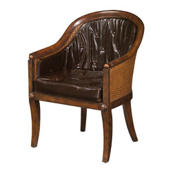 """Theodore Alexander - Sumptuous Sabre Leg Bergere Chair - A mahogany scoop back library Bergeree armchair, the caned back and seat with a loose cushion and shaped loose backrest, on sabre legs capped with roundels.  Based on the original Regency, circa 1815 sold at auction in London for $10,000.  Seat Height: 19 1/2""""  Arm Height: 25 3/4""""  Theodore Alexander upholstery uses the finest quality materials and is hand applied by expert craftspeople to ensure the highest standards in comfort, longevity and style.  Our craftsmen select wood based on beauty, colour and suitability to each individual piece.  We still use traditional furniture making, wood working techniques and materials to ensure enduring quality in every one of our products."""
