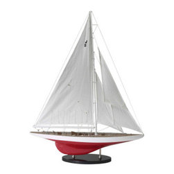 """J-Yacht Ranger 1937 - The J-Yacht Ranger 1937 measures 27.25""""L x 5.5""""W x 35""""H. J-Yachts are the most famous historical racing yachts. The top of it's hull is painted white and the bottom is painted red. The quality of this ship is unsurpassed. It has been made with the highest quality parts such as: fabric sails with detailed stitching and rigging, solid brass antiqued hardware made from individual molds and decking, a japanned lacquer ware stand with chrome fittings and hulls built plank on frame like the original dockyard models. The plans and drawings for this ship were researched in the archives of museums and national libraries. The ship was completely hand made by skilled craftsmen and women. It can be found in the Oval Office at the White House, Wall street offices and private libraries."""