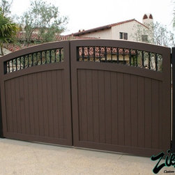 Driveway Gates - Motorized Entry Gates are the perfect compliment to your front yard. Our gates can be made on a steel frame or by using a triple layer method of construction. Either way, we will custom build it for you.