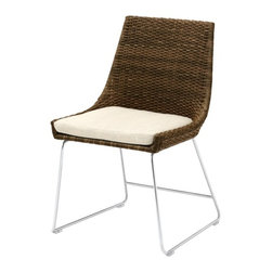 McGuire Furniture - Woven Shelter Chair - The Woven Shelter Chair is an exceptional example of melding first-rate materials with striking design. Meticulously woven on both sides for a seamless, tailored look, the weaving alone requires seven days to complete. The silhouette is slender but substantial, and the beauty of the material shines through.