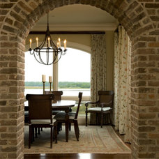 Traditional Dining Room by Island Architects