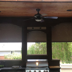 Rollshutters to enclose Patio - Rollshutters installed on patio to protect kitchen from weather and to provide security. (half open)